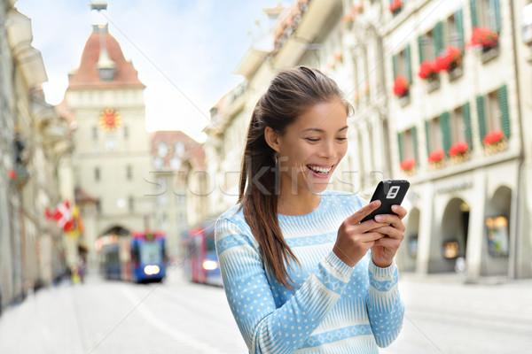 Woman on smart phone in Bern Switzerland Stock photo © Maridav