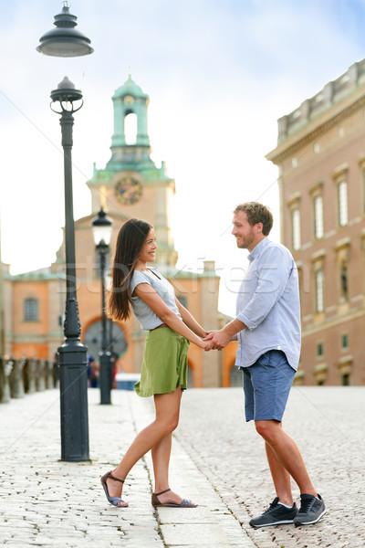 Pár szeretet kéz a kézben városi Svédország Stockholm Stock fotó © Maridav