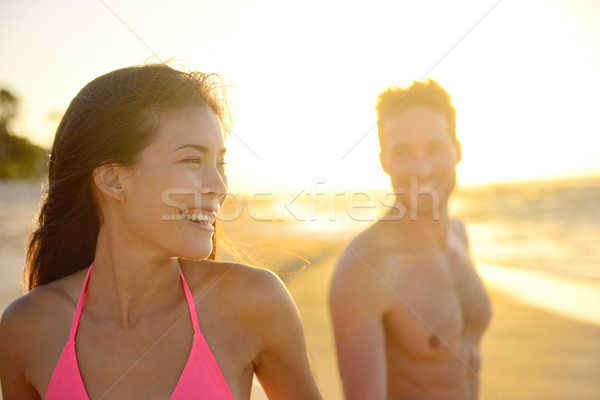 Stock photo: Smiling romantic young couple in beach sunset