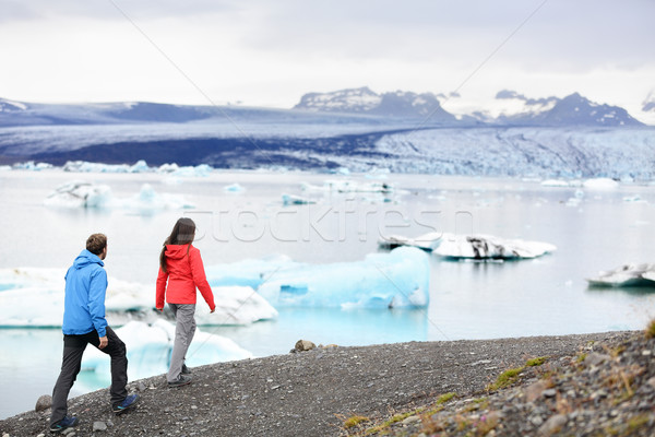 Hiking couple on Iceland Jokulsarlon glacier lake Stock photo © Maridav