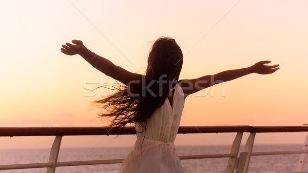 Stock photo: Cruise ship vacation woman enjoying sunset travel