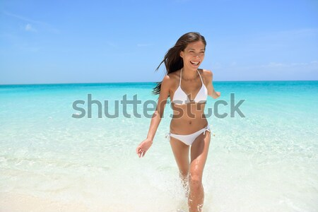 Sexy bikini body woman relaxing on beach - weight loss or epilation concept Stock photo © Maridav