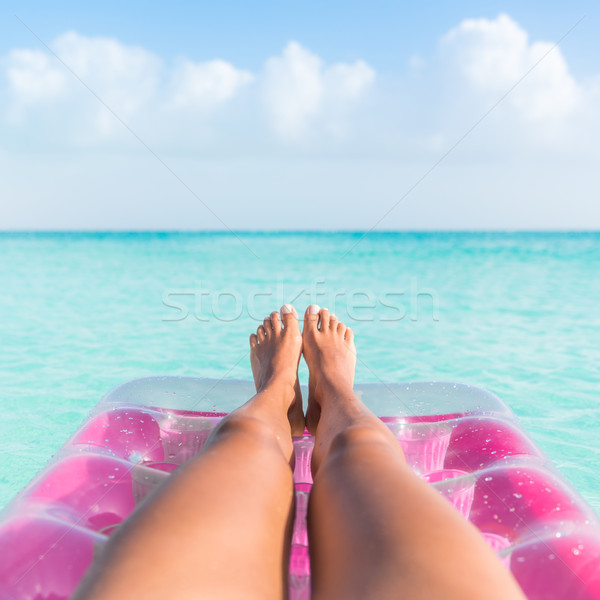 Stock photo: Summer holiday girl tanning legs relaxing in ocean