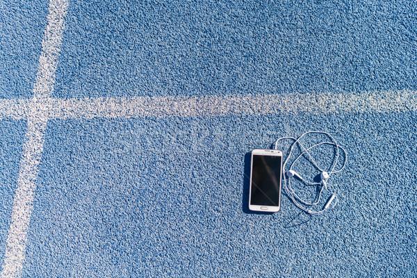 Running track and field lane mobile phone music Stock photo © Maridav