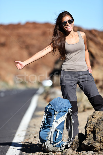 Travel hitchhiker woman happy Stock photo © Maridav
