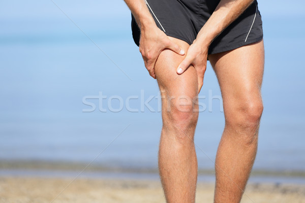 Muscle injury. Man with sprain thigh muscles Stock photo © Maridav