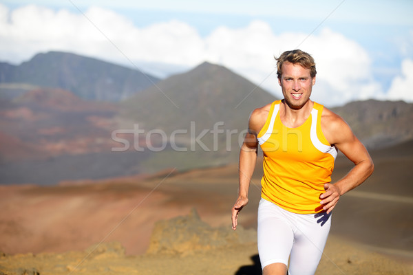 Running athlete - man runner sprinting fast Stock photo © Maridav