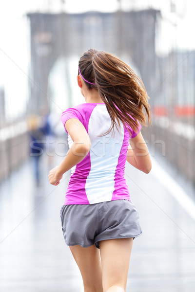 City runner - woman running on Brooklyn Bridge Stock photo © Maridav