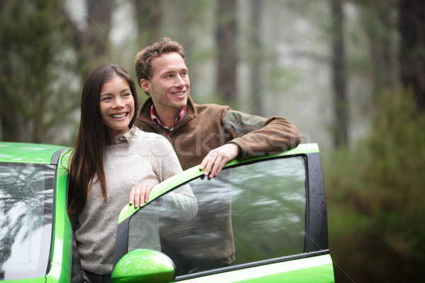 Stock photo: Driving in car - driver couple resting looking