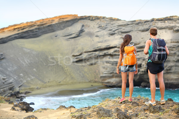 Hikers - travel couple tourists hiking on Hawaii Stock photo © Maridav