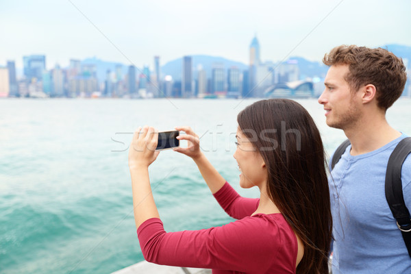 Tourist couple looking Victoria harbour Hong Kong Stock photo © Maridav