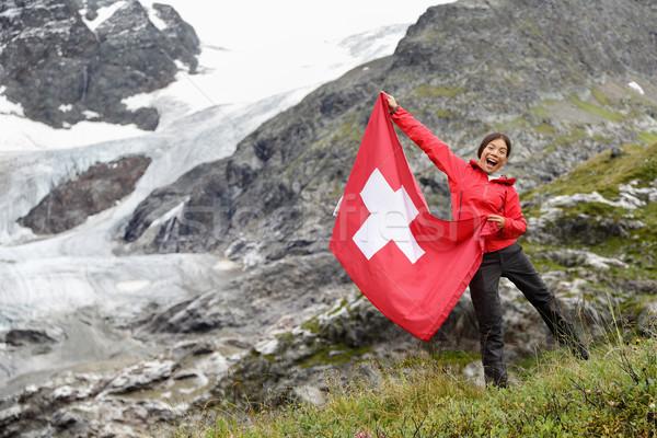 Switzerland hiker cheering showing Swiss flag Stock photo © Maridav
