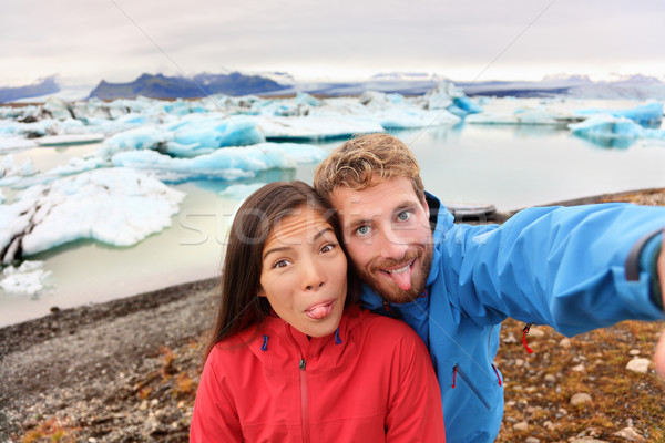 Funny selfie couple having fun on Iceland Stock photo © Maridav