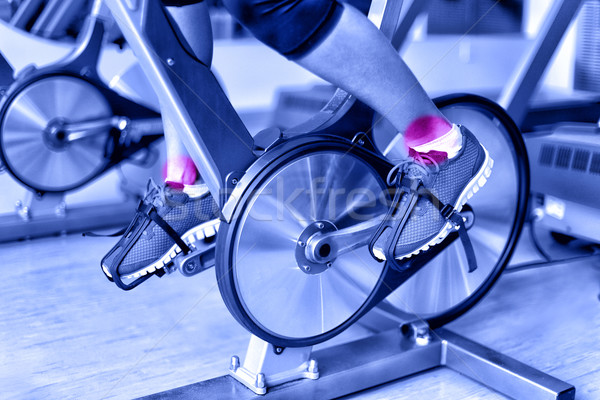 Sports injury - ankle pain on spinning bike at gym Stock photo © Maridav