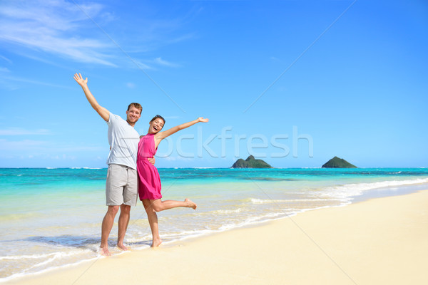 Beach vacation happy carefree couple arms raised Stock photo © Maridav