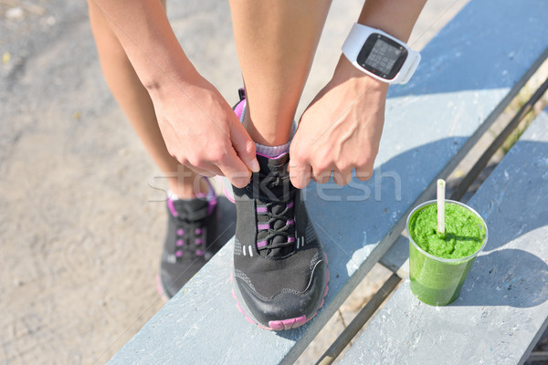 Running shoes green smoothie and sports smartwatch Stock photo © Maridav