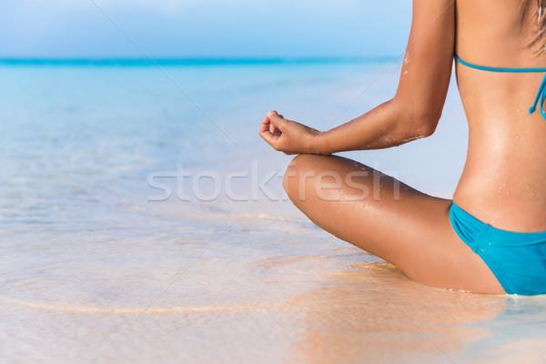 Yoga meditation bikini woman meditating on beach Stock photo © Maridav
