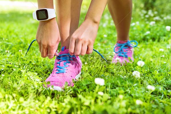 Active lifestyle smartwatch runner tying shoes  Stock photo © Maridav