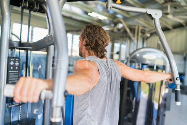 Man strength training hard at fitness gym center Stock photo © Maridav