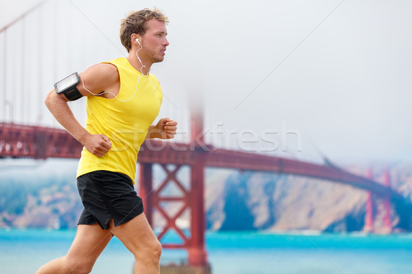Athlete running man runner - San Francisco living Stock photo © Maridav