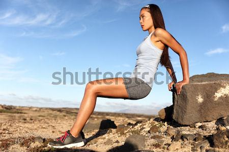 Fitness woman tying running shoes laces for race Stock photo © Maridav