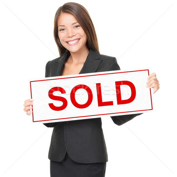 Realtor / Real estate agent woman sold sign on white background Stock photo © Maridav