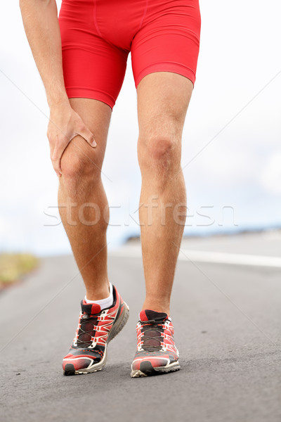 Stock photo: Knee pain - running sport injury