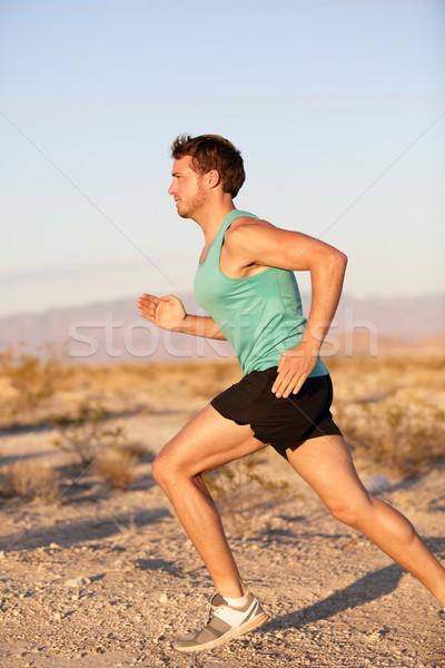 Runner sport man running and sprinting outside Stock photo © Maridav