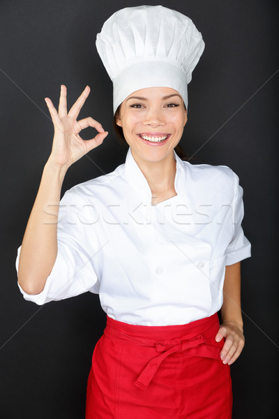 Chef woman giving a Perfect gesture with hand Stock photo © Maridav