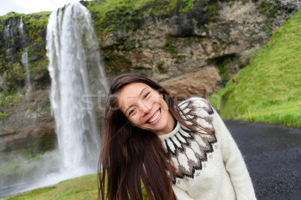 Woman on Iceland in Icelandic sweater by waterfall Stock photo © Maridav