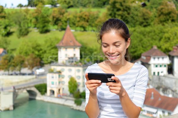 Woman using smart phone app in Bern Switzerland Stock photo © Maridav