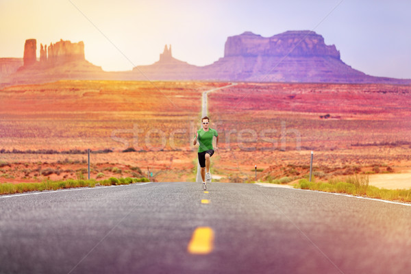 Runner man athlete running on road Monument Valley Stock photo © Maridav