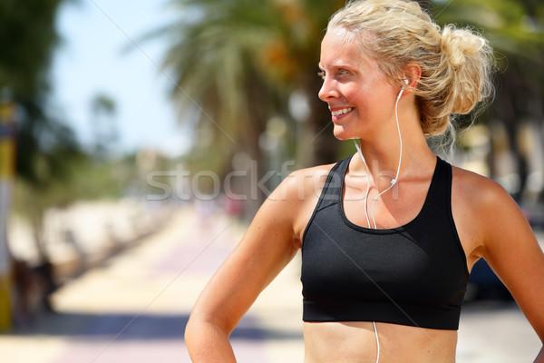 Running woman with earphones - runner portrait Stock photo © Maridav
