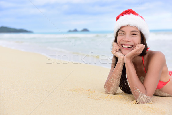 Christmas beach vacation - cute girl in santa hat Stock photo © Maridav