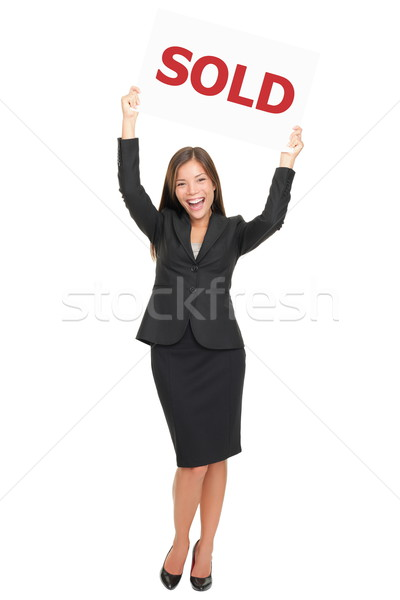 Realtor happy showing sold sign Stock photo © Maridav