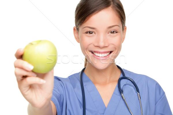 Zdjęcia stock: Pielęgniarki · jabłko · młodych · lekarza · uśmiechnięty