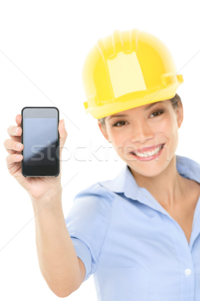 Stock photo: Engineer or architect woman showing smart phone