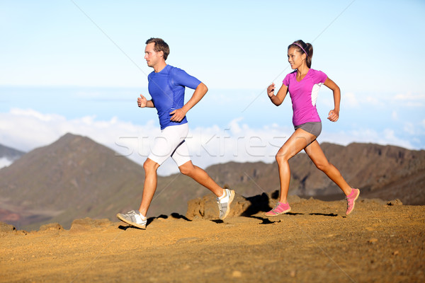 Running sport - Runners couple in trail run Stock photo © Maridav