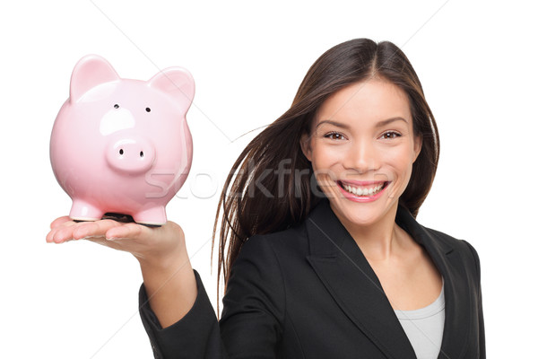 Businesswoman holding piggy bank - savings concept Stock photo © Maridav