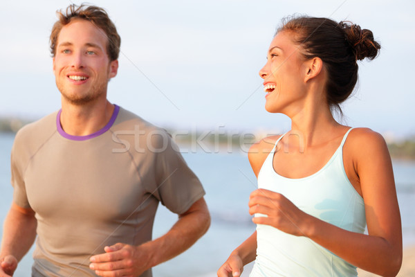 Jogging fitness young people running happy smiling Stock photo © Maridav