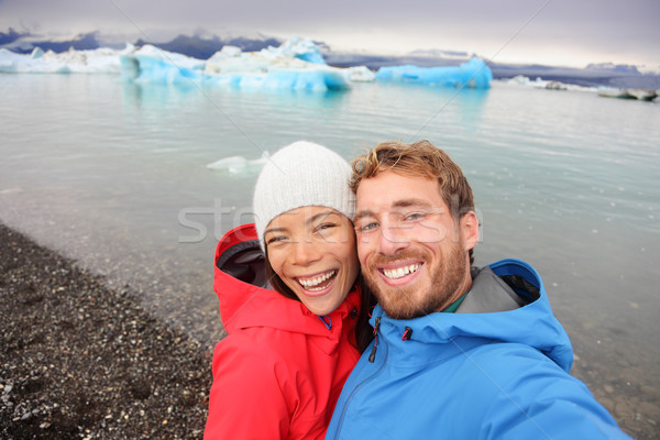 Stock photo: Couple taking selfie by Jokulsarlon on Iceland