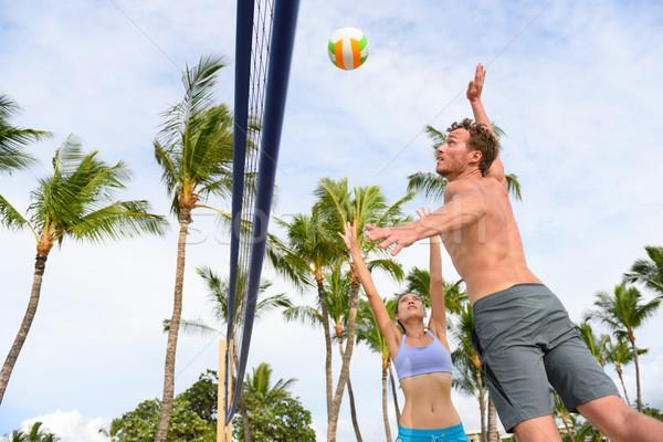 Barátok játszik tengerpart röplabda sport nyár Stock fotó © Maridav