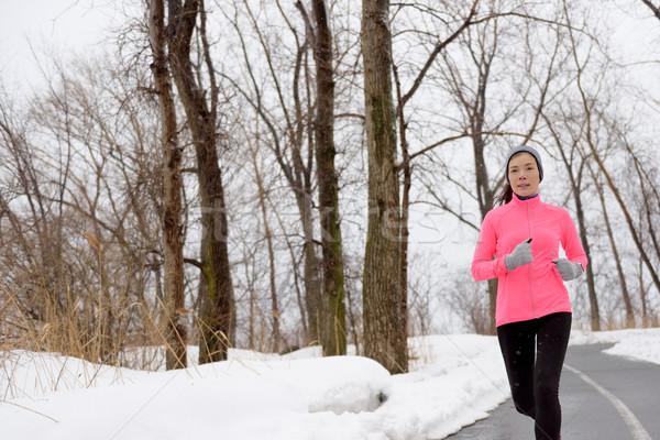 Winter cardio exercise - woman jogging running Stock photo © Maridav