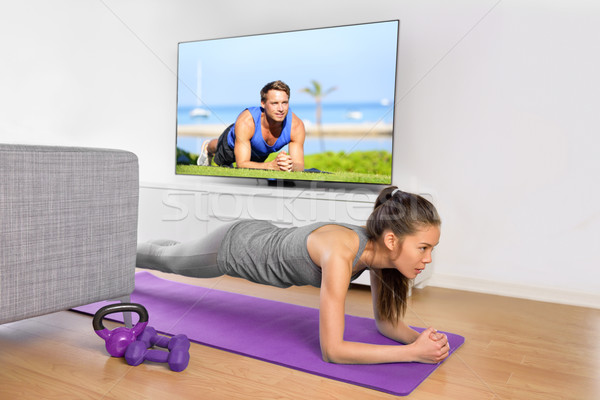 Living room exercises - girl doing plank at home Stock photo © Maridav