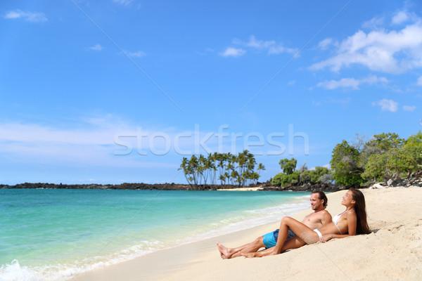Couple sunbathing on beach vacation relaxation Stock photo © Maridav