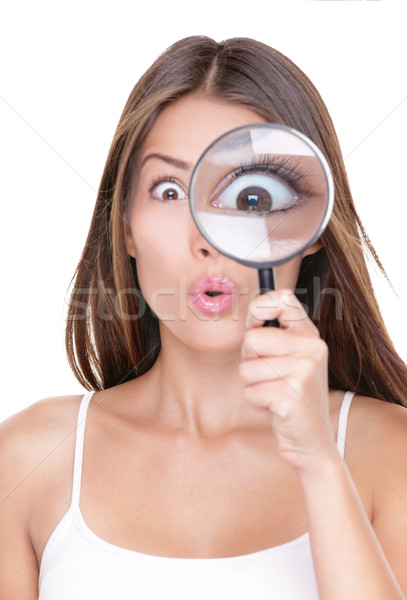Funny woman searching with magnifying glass Stock photo © Maridav