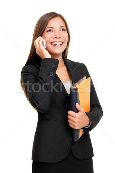 Real estate agent talking on mobile phone Stock photo © Maridav