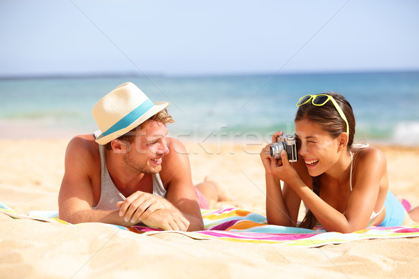 Beach fun couple travel - woman taking photo Stock photo © Maridav