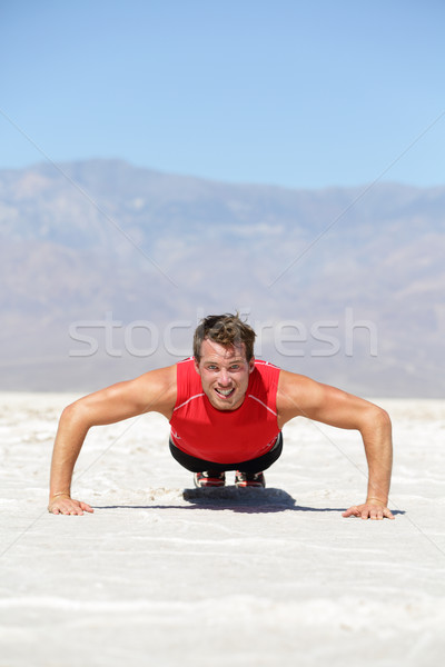 Fitness man crossfit training push-ups in desert Stock photo © Maridav