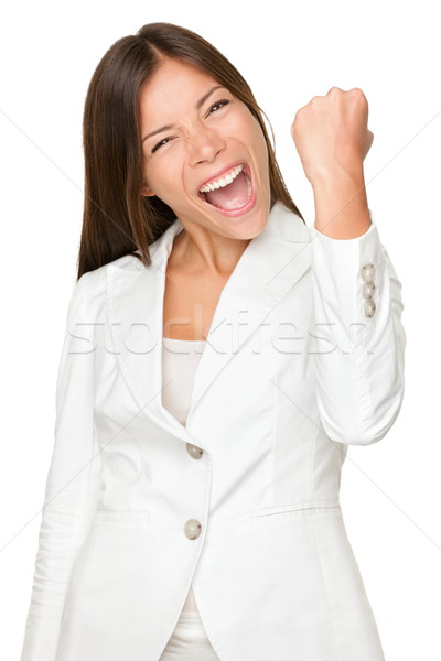 Energetic Businesswoman Clenching Fist Stock photo © Maridav